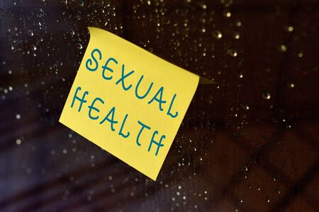 Conceptual hand writing showing Sexual Health. Concept meaning positive and respectful approach to sexual relationships Square paper piece notation stick to textured glass window Stock Photo - 127277960