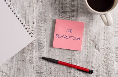 Handwriting text Job Description. Conceptual photo a formal account of an employee s is responsibilities Stationary placed next to a cup of black coffee above the wooden table