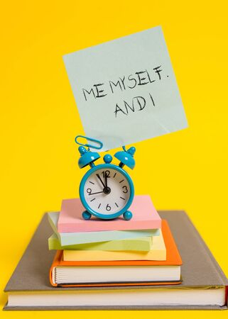 Handwriting text writing Me Myself And I. Conceptual photo used by speaker to refer to herself as the object of a verb Alarm clock note stacked notepads old books colored background