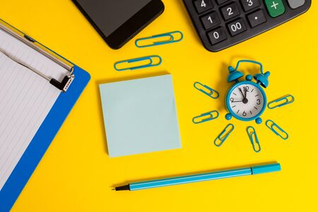 Alarm clipboard clips smartphone marker calculator notepad color background