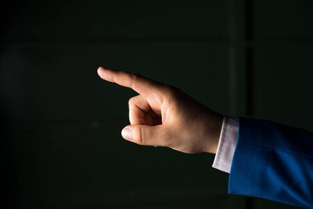 Isolated hand pointing with finger into copy space. Business concept with pointing finger.