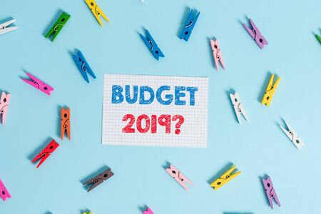 Handwriting text writing Budget 2019 Question. Conceptual photo estimate of income and expenditure for next year Colored clothespin rectangle shaped reminder paper light blue background Standard-Bild