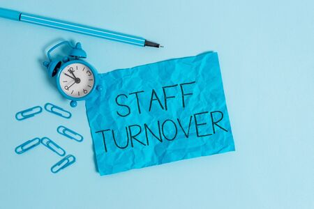 Word writing text Staff Turnover. Business photo showcasing The percentage of workers that replaced by new employees Metal alarm clock blank crushed sheet marker clips sky colored background Stock Photo