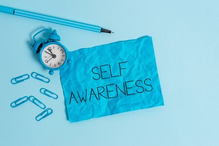 Word writing text Self Awareness. Business photo showcasing Consciousness of a demonstrating towards a situation or happenings Metal alarm clock blank crushed sheet marker clips sky colored background