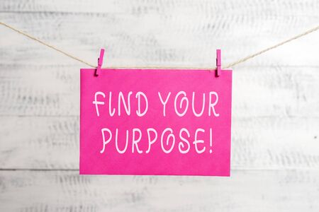 Word writing text Find Your Purpose. Business photo showcasing reason for something is done or for which still exists Clothesline clothespin rectangle shaped paper reminder white wood desk