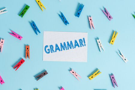 Handwriting text writing Grammar. Conceptual photo whole system structure language syntax and morphology Colored clothespin rectangle shaped reminder paper light blue background