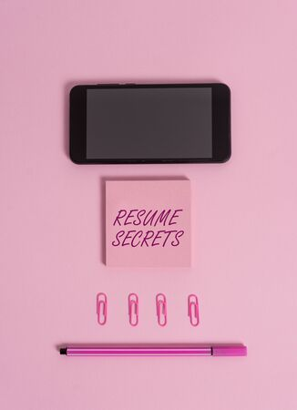 Text sign showing Resume Secrets. Business photo showcasing Tips on making amazing curriculum vitae Standout Biography Colored blank sticky note clips smartphone pen trendy pastel background Stock Photo