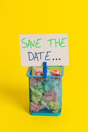 Text sign showing Save The Date. Business photo showcasing Organizing events well make day special event organizers Trash bin crumpled paper clothespin empty reminder office supplies yellow