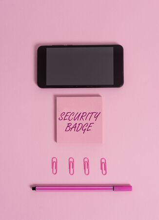 Text sign showing Security Badge. Business photo showcasing Credential used to gain accessed on the controlled area Colored blank sticky note clips smartphone pen trendy pastel background Stock Photo