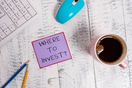 Handwriting text Where To Invest question. Conceptual photo asking about actions or process of making more money