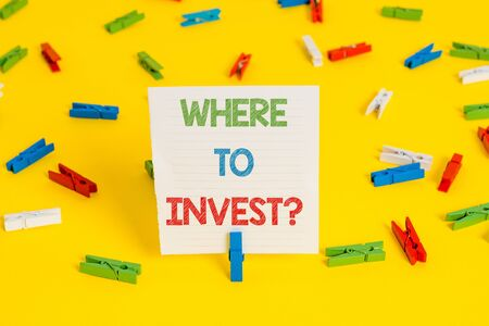Conceptual hand writing showing Where To Invest question. Concept meaning asking about actions or process of making more money
