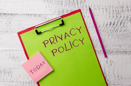 Word writing text Privacy Policy. Business photo showcasing Document that explains how an organization handles clients Metal clipboard paper sheets marker sticky notes pad wooden background