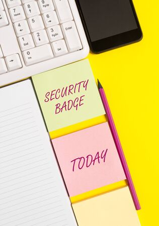 Conceptual hand writing showing Security Badge. Concept meaning Credential used to gain accessed on the controlled area Empty papers with copy space on yellow background table