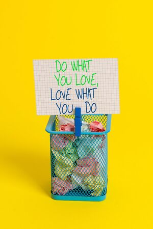Text sign showing Do What You Love Love What You Do. Business photo showcasing you able doing stuff you enjoy it to work in better places then Trash bin crumpled paper clothespin empty reminder office supplies yellow