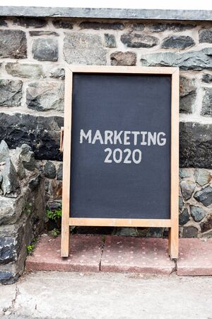 Handwriting text writing Marketing 2020. Conceptual photo Commercial trends for 2020 New Year promotional event Empty black board with copy space for advertising. Blank dark board