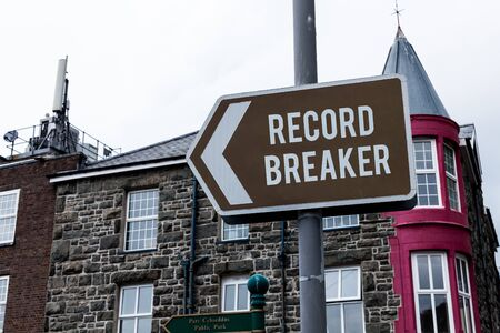 Text sign showing Record Breaker. Business photo showcasing someone or something that beats previous best result Empty street signs on the crossroads with blank copy space 스톡 콘텐츠