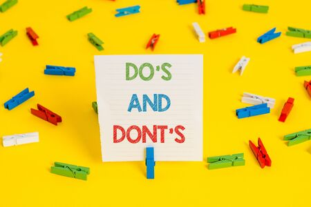 Conceptual hand writing showing Do S Is And Dont S Is. Concept meaning advising Rules or customs concerning some activity