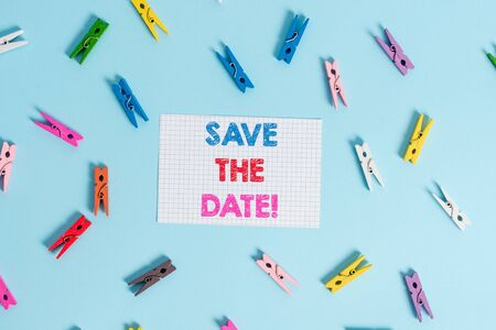 Handwriting text writing Save The Date. Conceptual photo Organizing events well make day special event organizers Colored clothespin rectangle shaped reminder paper light blue background Фото со стока