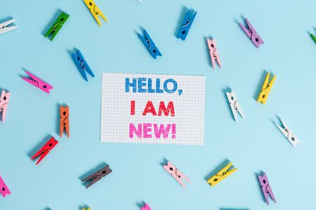 Handwriting text writing Hello I Am New. Conceptual photo used as greeting or to begin telephone conversation Colored clothespin rectangle shaped reminder paper light blue background