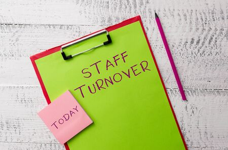 Word writing text Staff Turnover. Business photo showcasing The percentage of workers that replaced by new employees Metal clipboard paper sheets marker sticky notes pad wooden background
