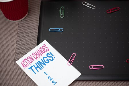 Text sign showing Action Changes Things. Business photo text start doing something against problem resolve or achieve it Scissors and writing equipments plus math book above textured backdrop Stock fotó