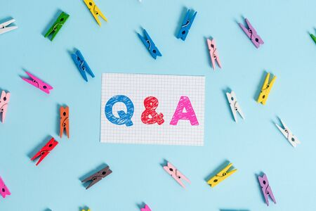 Handwriting text writing Q And A. Conceptual photo defined as questions being asked and answers Colored clothespin rectangle shaped reminder paper light blue background 写真素材