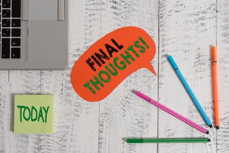 Text sign showing Final Thoughts. Business photo text should be last few sentences within your conclusions Open laptop speech bubble ballpoints sticky notes vintage wooden table Standard-Bild