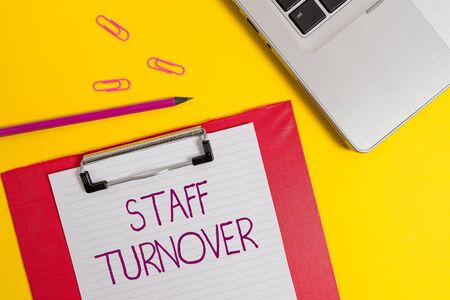 Text sign showing Staff Turnover. Business photo text The percentage of workers that replaced by new employees Slim metallic laptop clipboard paper sheet clips pencil colored background