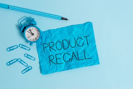 Word writing text Product Recall. Business photo showcasing Request by a company to return the product due to some issue Metal alarm clock blank crushed sheet marker clips sky colored background 免版税图像