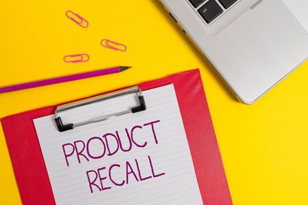 Text sign showing Product Recall. Business photo text Request by a company to return the product due to some issue Slim metallic laptop clipboard paper sheet clips pencil colored background 免版税图像