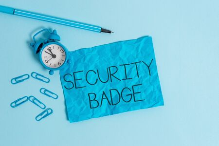 Word writing text Security Badge. Business photo showcasing Credential used to gain accessed on the controlled area Metal alarm clock blank crushed sheet marker clips sky colored background