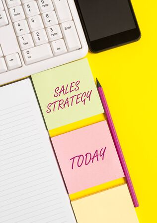 Conceptual hand writing showing Sales Strategy. Concept meaning Plan for reaching and selling to your target market Marketing Empty papers with copy space on yellow background table