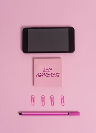Text sign showing Self Awareness. Business photo showcasing Consciousness of a demonstrating towards a situation or happenings Colored blank sticky note clips smartphone pen trendy pastel background Imagens