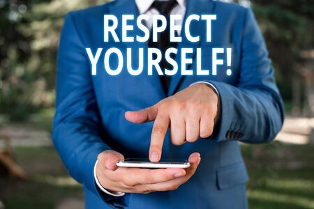 Writing note showing Respect Yourself. Business concept for believing that you good and worthy being treated well Businessman with pointing finger in front of him