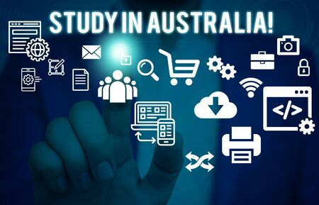 Word writing text Study In Australia. Business photo showcasing going into foreign country order complete your studies Male human wear formal work suit presenting presentation using smart device