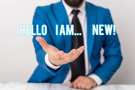 Text sign showing Hello I Am New. Business photo text used as greeting or to begin telephone conversation Man holds empty paper with copy space in front of him Copy Space