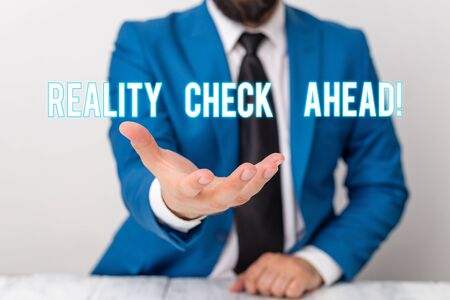 Text sign showing Reality Check Ahead. Business photo text makes them recognize truth about situations or difficulties Man holds empty paper with copy space in front of him Copy Space