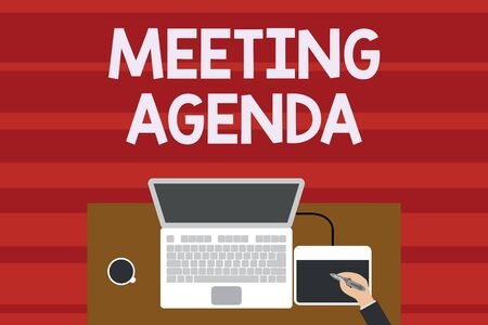 Text sign showing Meeting Agenda. Business photo text An agenda sets clear expectations for what needs to a meeting Upper view laptop wooden desk worker drawing tablet coffee cup office