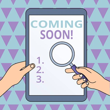 Conceptual hand writing showing Coming Soon. Concept meaning event or action that will happen after really short time Hands Holding Magnifying Glass Against Switched Off Tablet Imagens