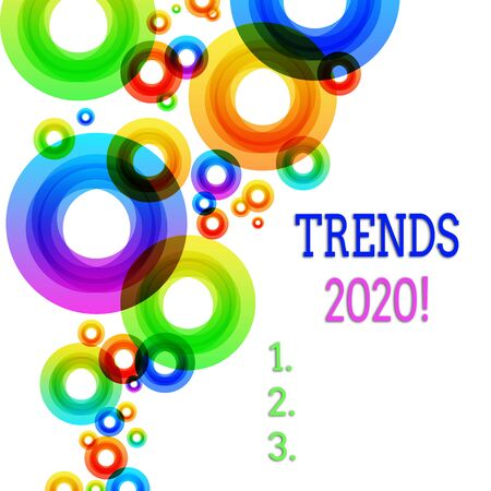 Word writing text Trends 2020. Business photo showcasing general direction in which something is developing or changing Vibrant Multicolored Circles Disks of Different Sizes Overlapping Isolated
