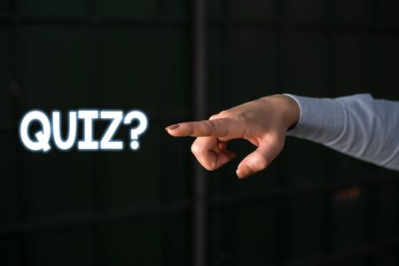 Text sign showing Quiz Question. Business photo showcasing test of knowledge as competition between individuals or teams Finger pointing in the Dark with hand pointing in the copy space