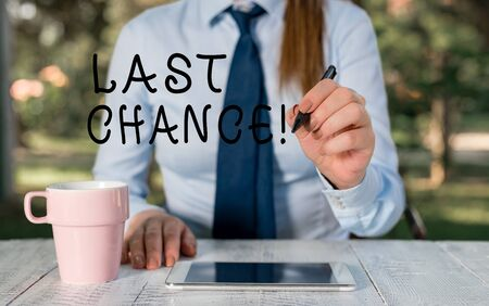 Writing note showing Last Chance. Business concept for final opportunity to achieve or acquire something you want Female business person sitting by table and holding mobile phone Stock fotó