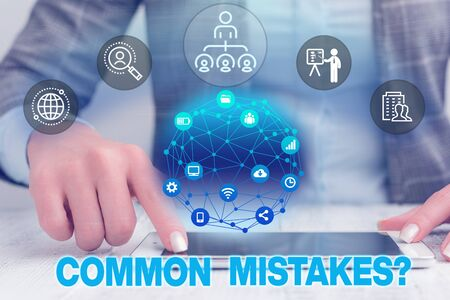 Text sign showing Common Mistakes . Business photo text repeat act or judgement misguided or wrong Female human wear formal work suit presenting presentation use smart device