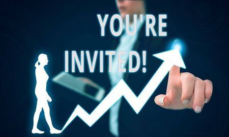 Text sign showing You Re Invited. Business photo text make a polite friendly request to someone go somewhere Female human wear formal work suit presenting presentation use smart device Stock Photo