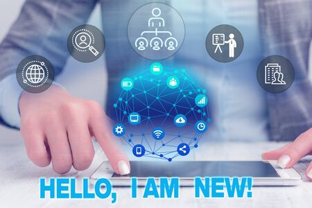 Text sign showing Hello I Am New. Business photo text used as greeting or to begin telephone conversation Female human wear formal work suit presenting presentation use smart device