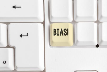 Word writing text Bias. Business photo showcasing inclination or prejudice for or against one demonstrating group White pc keyboard with empty note paper above white background key copy space