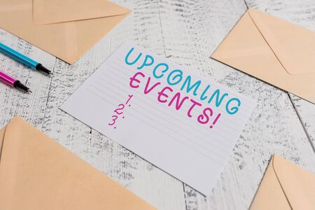 Word writing text Upcoming Events. Business photo showcasing thing that will happens or takes place soon planned occasion Envelopes highlighters ruled paper sheet wooden retro vintage background