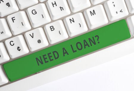 Text sign showing Need A Loan Question. Business photo showcasing asking he need money expected paid back with interest White pc keyboard with empty note paper above white background key copy space