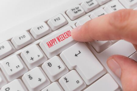 Word writing text Happy Weekend. Business photo showcasing something nice has happened or they feel satisfied with life White pc keyboard with empty note paper above white background key copy space 写真素材