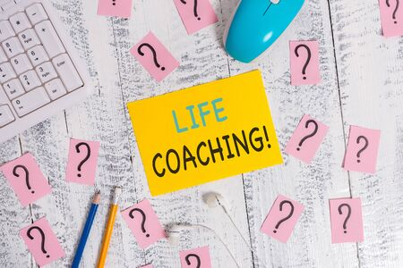 Writing note showing Life Coaching. Business concept for demonstrating employed to help showing attain their goals in career Writing tools and scribbled paper on top of the wooden table Stockfoto